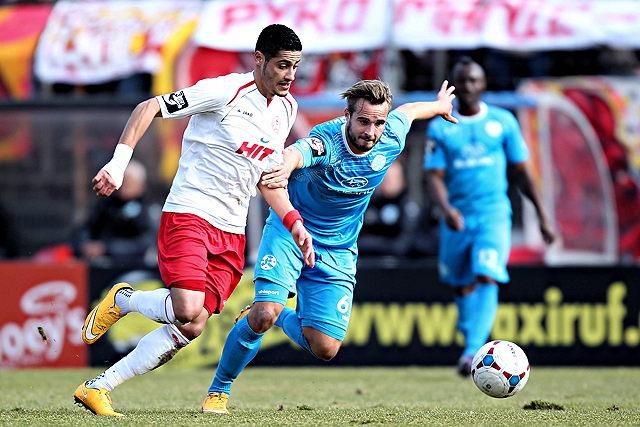 Treffen sich zum Saisonauftakt wieder: Fortuna Kölns Hamdi Dahmani (l.) und der Stuttgarter Sandrino Braun Foto: imago/Mika