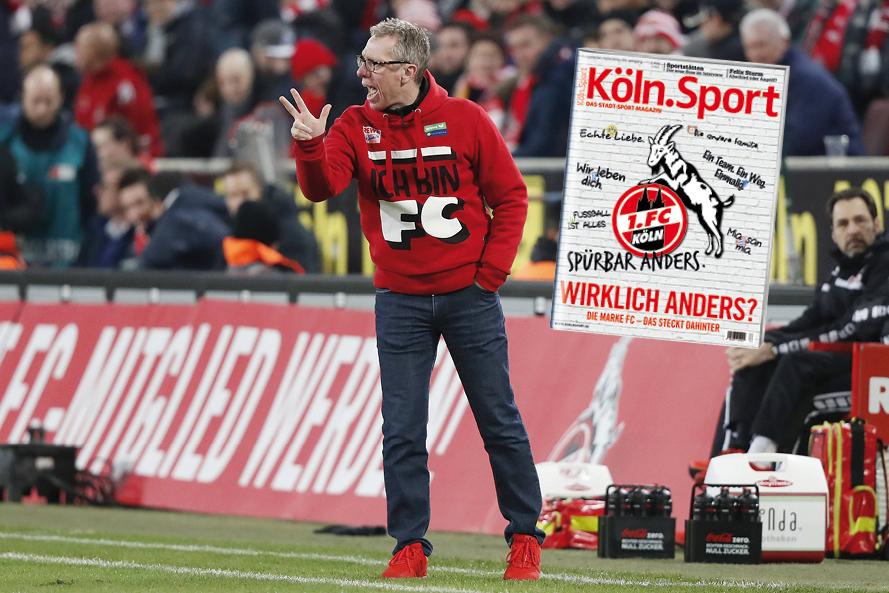 FC-Trainer Peter Stöger trägt das Marken-Motto auf der Brust.